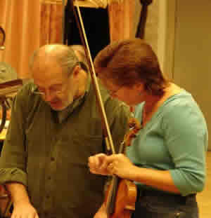 Photo taken two days before recording, conductor Mátyás Antal and violinist Rebekah Binford discuss the score. Budapest, Hungary (19 September 2007)