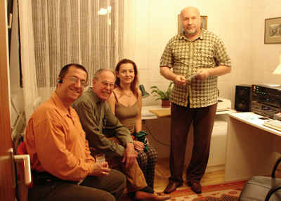 Photo during the presentation of the completed mastered CD: from left, producer Dávid Zsolt Király, composer Harold Schiffman, interpreter Szidónia Juhász, and recording engineer István Biller. Budafok, Hungary (24 September 2007)