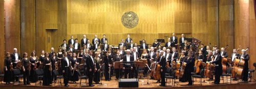 Photo of The Győr Philharmonic Orchestra (Győri Filharmonikus Zenekar) on the stage of the orchestra's home: The János Richter Hall, Győr, Hungary. Photograph courtesy of the Győr Philharmonic Orchestra (http://www.gyorifilharmonikusok.hu/)