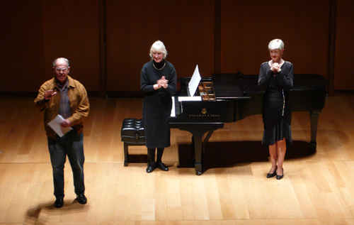 Photo after world première of Blood Mountain (2007);  Harold Schiffman receiving applause from the audience, pianist Jane Perry-Camp, and soprano Gayle Seaton;  Gilder Lehrman Hall (9 March 2008). Photograph by Gerd-Uwe Johnson