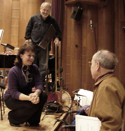 Photo of Katalin Halmai (kneeling), Mátyás Antal (standing in background), Harold Schiffman (right foreground) at the conclusion of Alma's rehearsal, Győr, Hungary (15 October 2008)