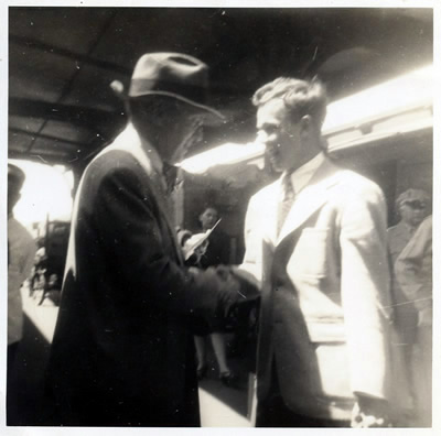 Harold Schiffman with Randall Thompson at the Greensboro Railroad Station, seeing Thompson off for Thompson's return to Princeton. Greensboro, North Carolina (Spring 1946) Photographer unknown