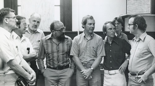 Krzysztof Penderecki (fourth from the left) met with resident composers and students during his visiting professorship at Florida  State University's School of Music.  Harold Schiffman (second from the  left) was Penderecki's special assistant during the visiting professorship. Tallahassee, Florida (Spring 1975) Photographer unknown