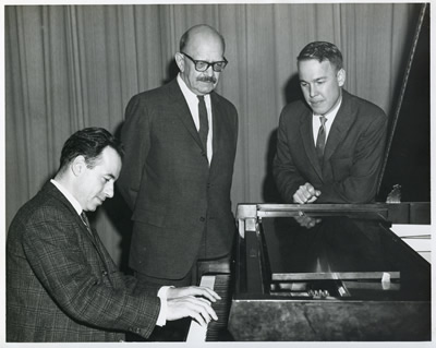 Roger Sessions (center), with whom Harold Schiffman had studied, was the guest composer for the Florida Composers League's meeting at Florida State University, where he is seen here with Leonard Mastrogiacomo (left) who performed Sessions' second piano sonata at the meeting -- and who two years earlier had premièred the Sonata No. 1 for Piano (1951) of Harold Schiffman (seen at the right). Tallahassee, Florida (16 March 1963) Photograph by Ken Richards of the FSU News Bureau