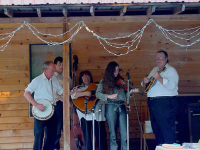 Harold Schiffman playing with Bill and Wilma Millsaps and the Snowbird Mountain Band at the opening of new restaurant, in Reliance, Tennessee. (L to R)  Harold Schiffman (banjo), Stephen Millsaps (bass); Wilma Millsaps (guitar); Abigail Moore (fiddle); Bill Millsaps (mandolin). (25 August 2001)