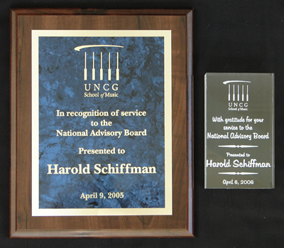 (Left) Photo of Plaque recognizing Harold Schiffman's service to the National Advisory Board of the School of Music, University of North Carolina at Greensboro. (Presented 9 April 2005).  (Right) Photo of eched trophy of gratitude for Harold Schiffman's service to the National Advisory Board of the School of Music, University of North Carolina at Greensboro (Presented 8 April 2006)