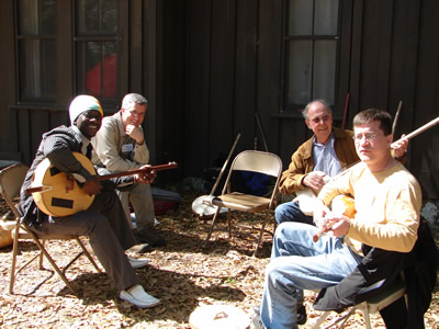 """African Roots,"" one of the Suwannee Banjo Camp's course sequences, offers ekonting classes such as this one.  (L to R) Sana Ndiaye (SBC faculty member, with his large ekonting), SBC faculty member Greg Adams, student and enthusiast Harold Schiffman, SBC faculty member Paul Sedgwick. Suwannee Banjo Camp, O'Leno State Park, Florida (21 March 2009)"