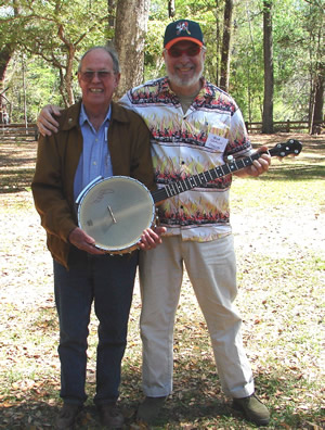 """Going for gold!""  Winner of the Suwannee Banjo Camp's silent auction, Harold Schiffman is joined by SBC faculty member and Gold Tone artist Bob Carlin – with Harold's newly won Gold Tone banjo. Suwannee Banjo Camp, O'Leno State Park, Florida (22 March 2009)"