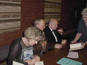 Photo of book and CD signing: Poet Kathryn Stripling Byer, composer Harold Schiffman, violoncellist David Moore. Coulter Recital Hall, Western Carolina University, Cullowhee, North Carolina (26 August 2004)