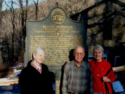 Photo of Soprano Gayle Seaton, composer Harold Schiffman, pianist Jane Perry-Camp at Georgia's Blood Mountain, with the State of Georgia's official marker describing the historical events that took place there (20 February 2010) [Photographer unknown]