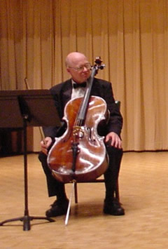Photo of David Moore, violoncellist, at première of Wake (2003). Coulter Recital Hall, Western Carolina University, Cullowhee, North Carolina (26 August 2004)