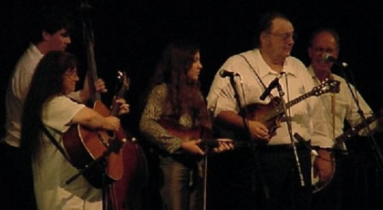 Photo of The Snowbird Mountain Band on stage at the Smoky Mountain Folk Festival at Lake Junaluska, North Carolina. (L-R) Wilma Millsaps on guitar; Stephen Millsaps on bass; Abigail Moore on fiddle; Bill Millsaps on mandolin; Harold Schiffman on banjo. (31 August 2001)